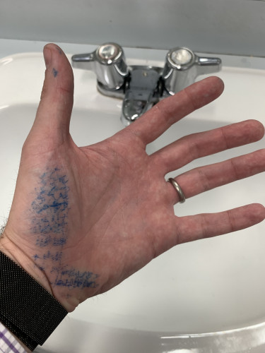 My hand covered in the blue ink that rubbed off from my notes